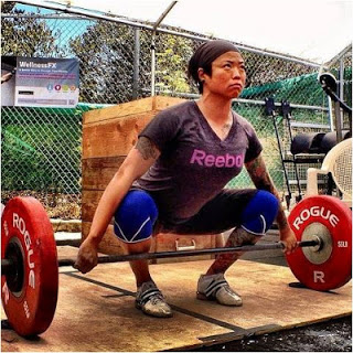 Diana herself, setting up for a snatch with her navel stacked over the bar and her shoulders over the navel