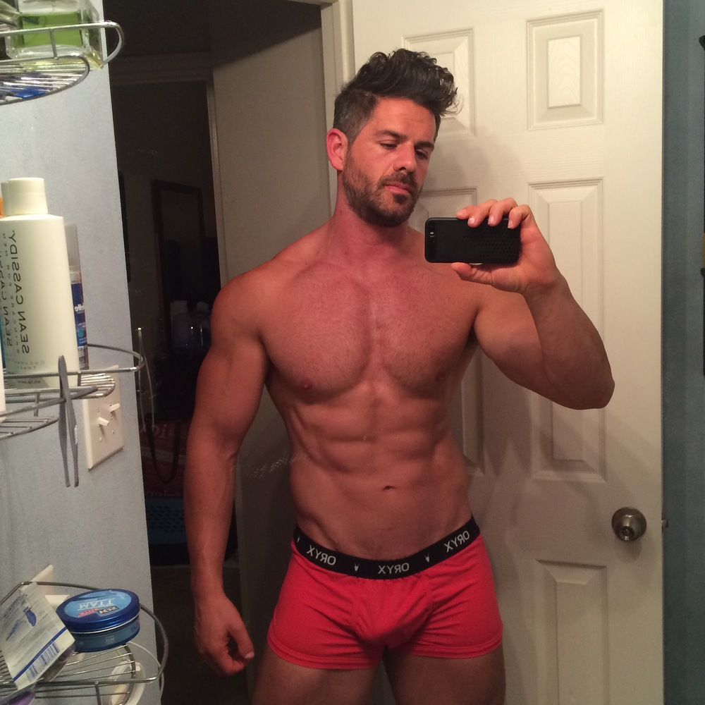Oryx Owner, model Eric Turner posing for a selfie in the Sport Trunk