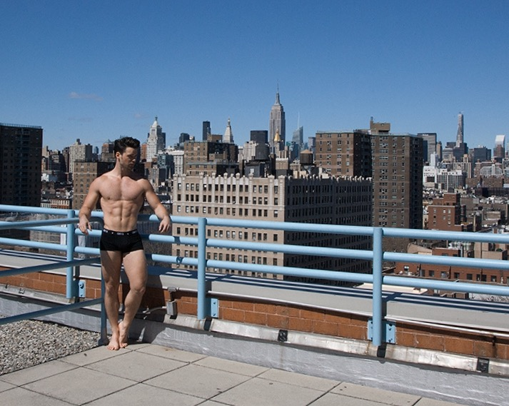 Matthew Hartwig pausing during a photoshoot with Rick Day to enjoy the Manhattan skyline