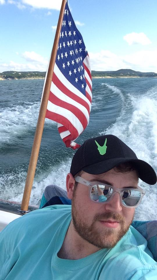 Kevin fighting off the sun while boating in the Oryx Cap