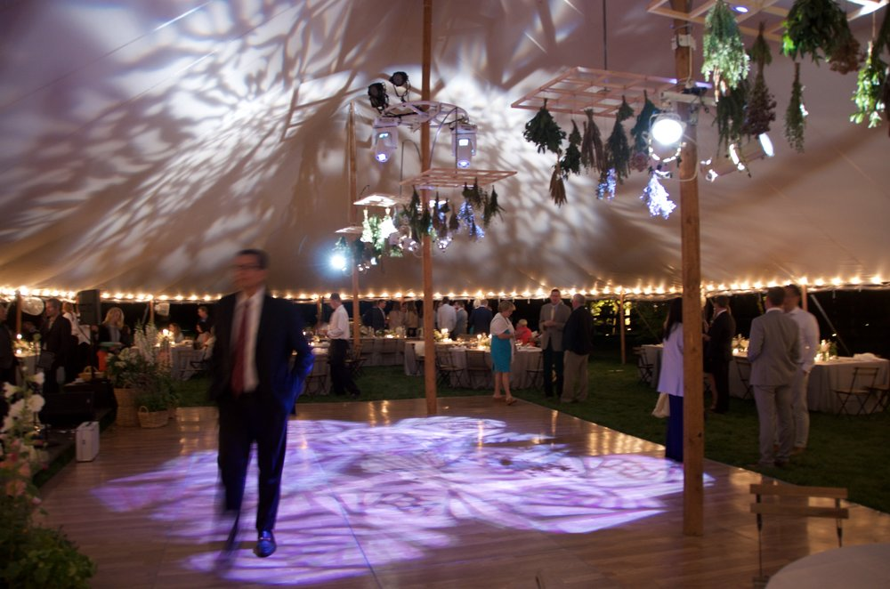 Patterned gobos and dance floor lighting for a tented wedding