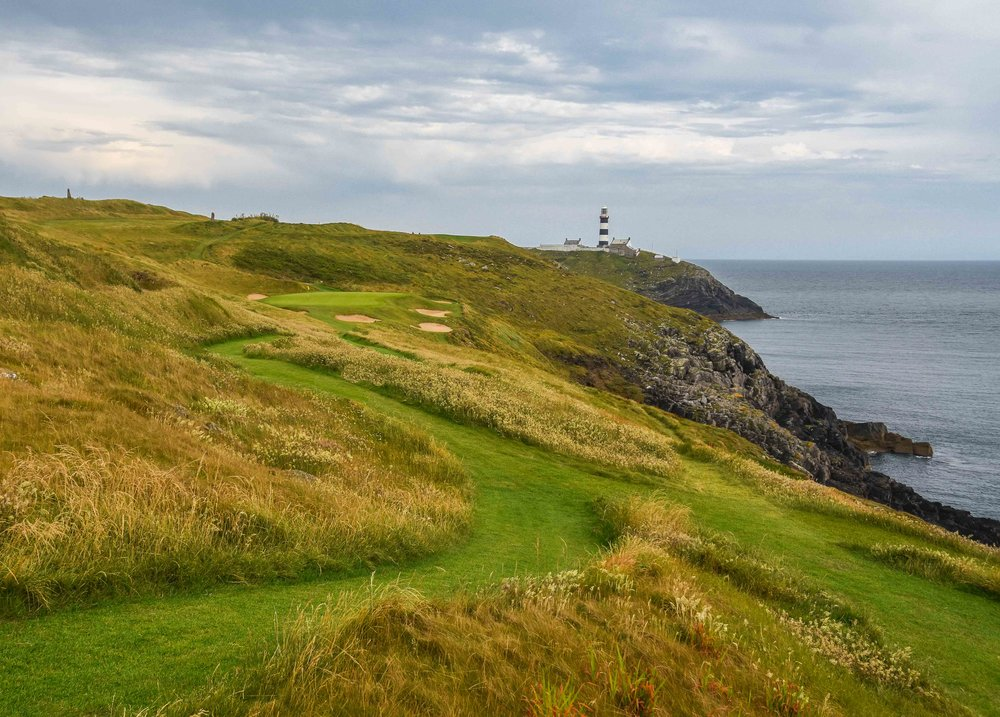 The par 3 16th at Old Head with the lighthouse in the distance.