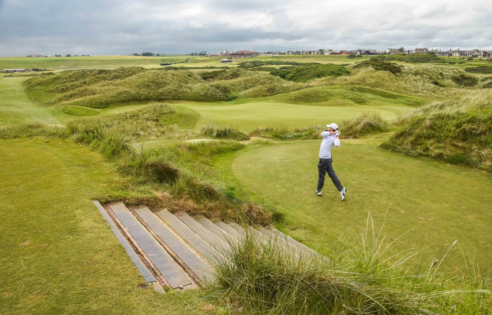 Chris Solomon pounds one deep at Cruden Bay's 6th hole.