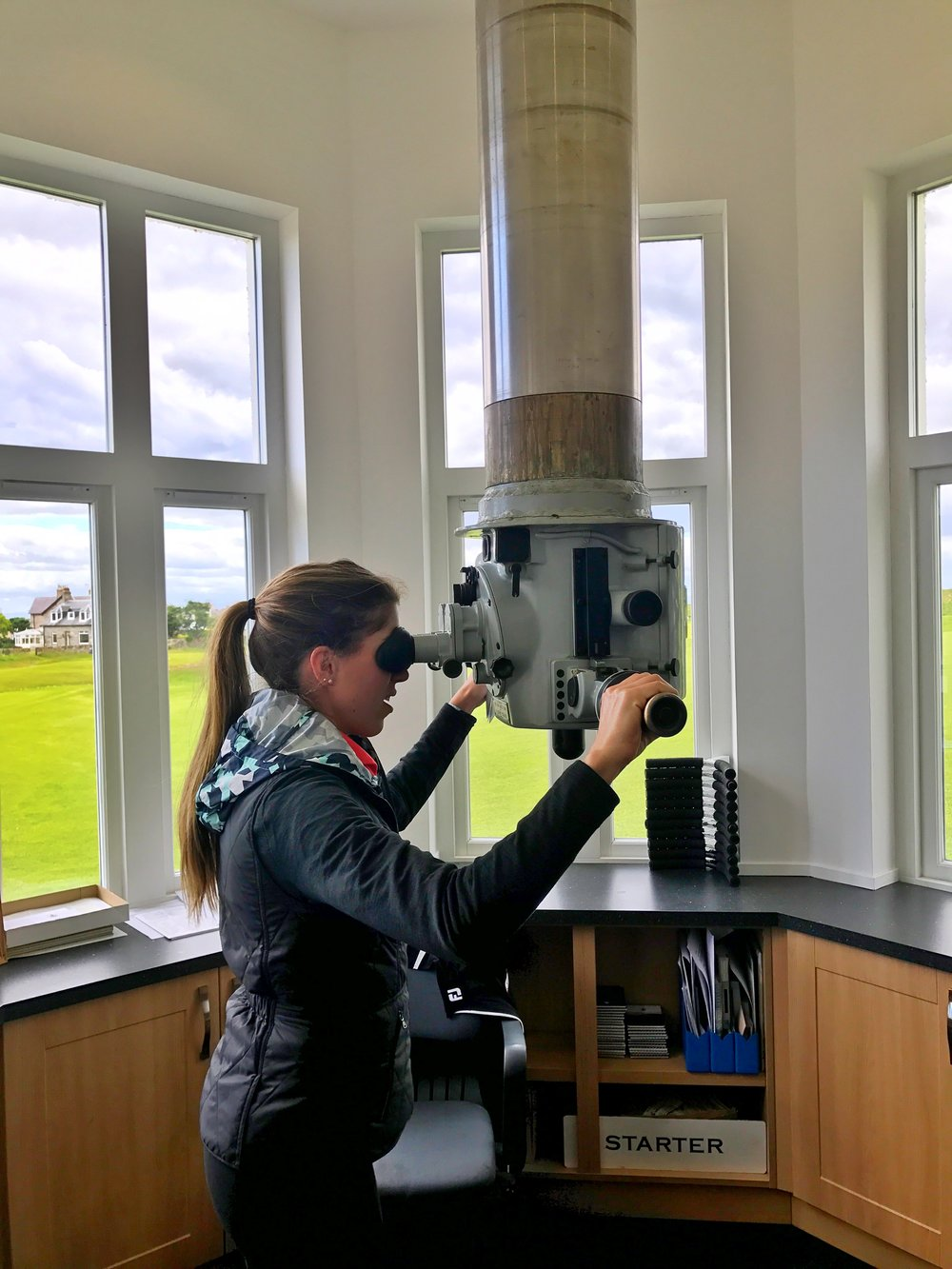 Ashley checks out the periscope clubhouse at Elie Golf Links.  This is an actual periscope from the HMS Excalibur submarine that allows the starter's office to alert golfers when the 1st fairway is clear.