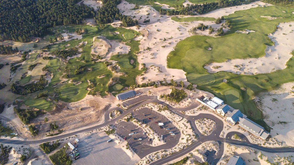 Even the parking lot at Sand Valley is filled with sand.  You can see the resort's par 3 course in the top left and the 1st tee and 18th green on Mammoth Dunes on the right.