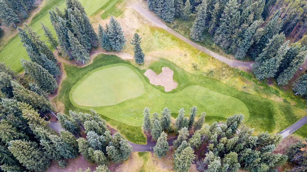 Even during a historically dry season, The short par 3 11th at Canmore Golf & Curling Club is still a stunner.