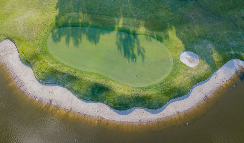 The 11th green features a pretty sweet beach bunker