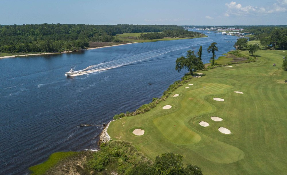 The double green of holes 18 and 9 at Glen Dornach lies right on the Intercoastal Waterway