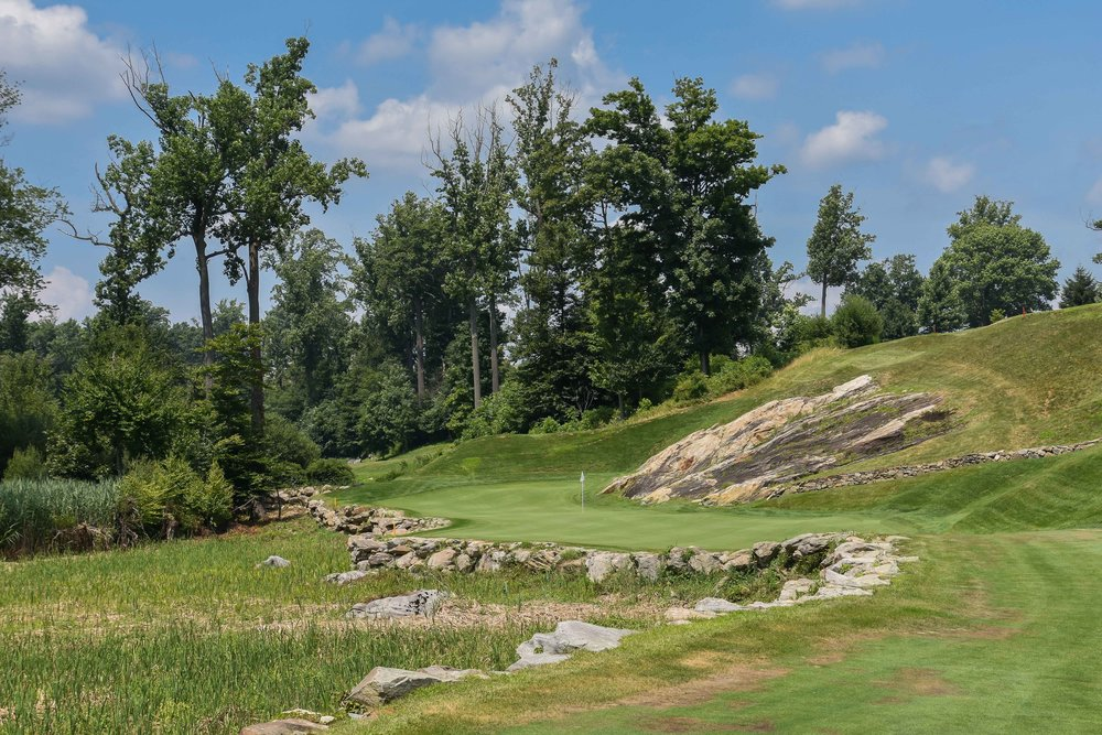 The 15th green at Pound Ridge offers an opportunity for the rare bank it off the rock birdie.