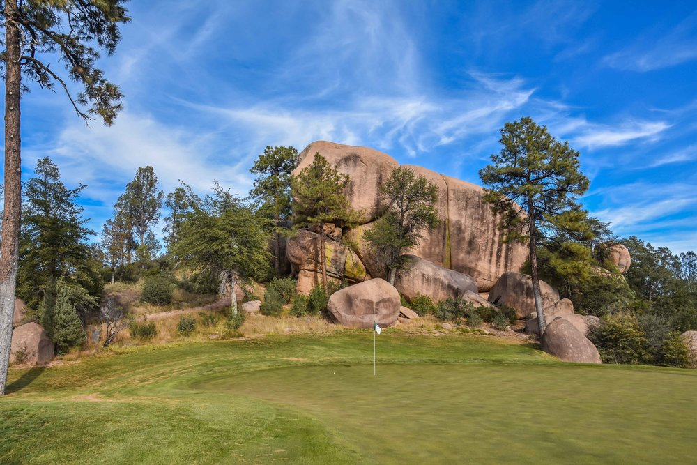 The 13th green is framed by some serious rocks.