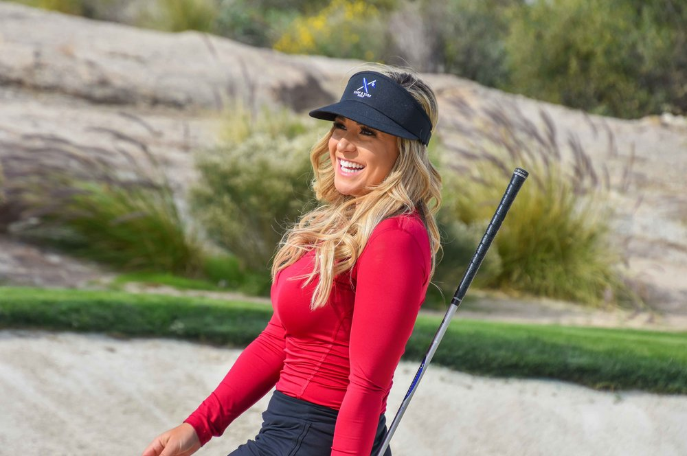 No matter the outcome, Chelsea smiles like a model after every golf shot. She bladed this one 75 yards into the middle of the desert.