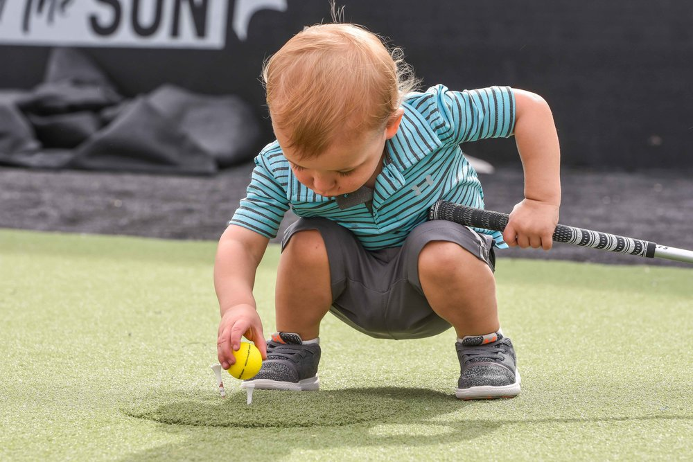 Not yet out of diapers, this young golfer was already calculating launch angles in between matches.