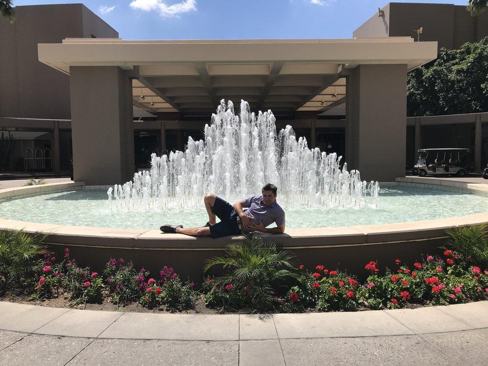 Male model fountain posing