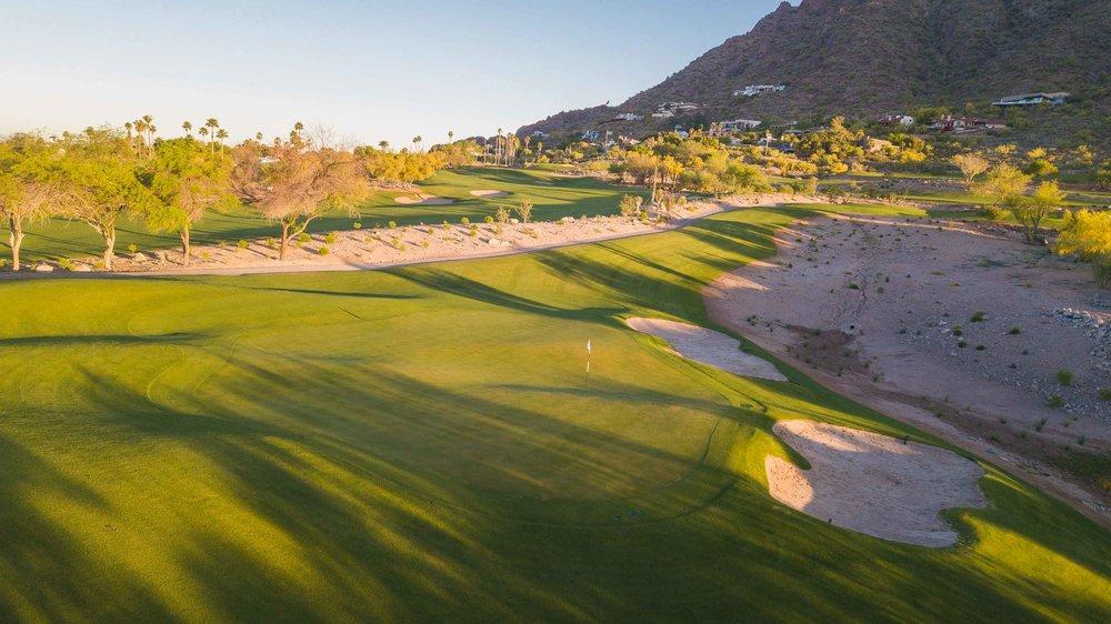 Sun rises over The Phoenician's 11th hole.