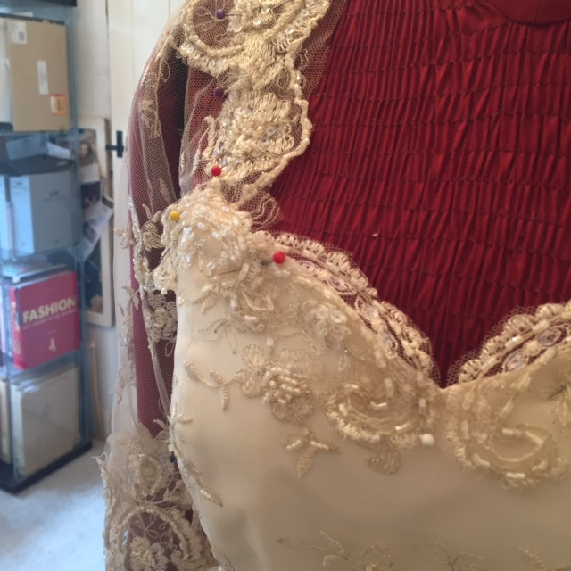 Adding the detailing to the front of the bodice.