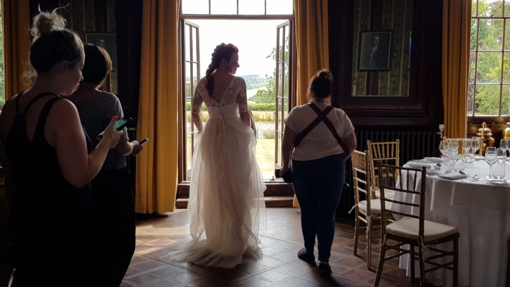 The team head through the beautiful drawing room into the sunshine filled gardens beyond!