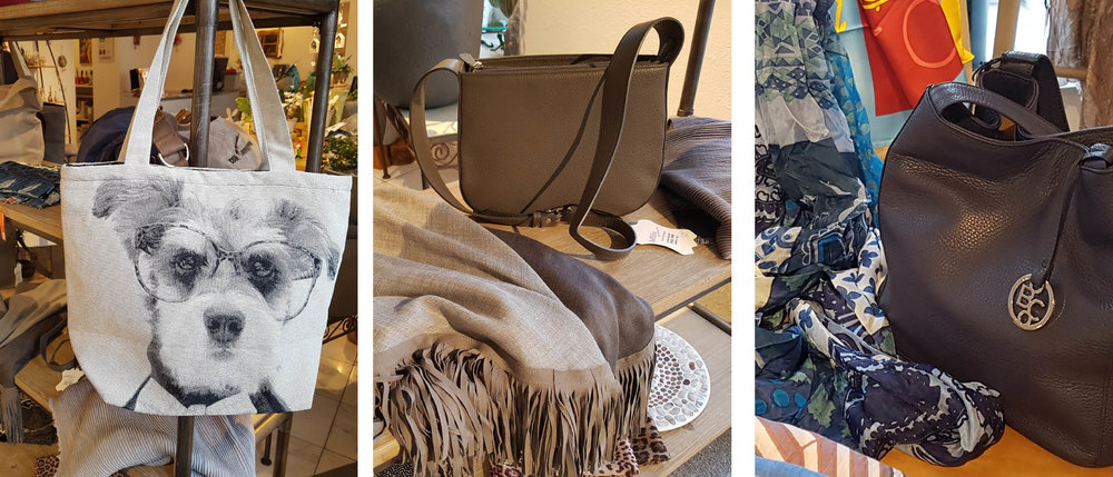 Fröhliche Shopper aus textilem Material, edle Schaltücher aus feinster Wolle mit Lederfransen (hellgrau, dunkelgrau, dunkelblau) und klassisch-elegante Ledertaschen mit hochwertiger Verarbeitung.