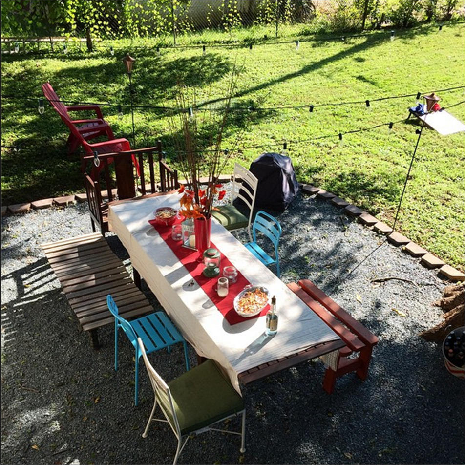 I love mismatching chairs and benches around a big table – everyone can pick their favorite spot!