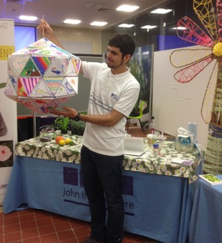 Roger Castells-Graells showing off the 80-sided virus structure built with the creative help of lots of kids at Norwich Science Festival.