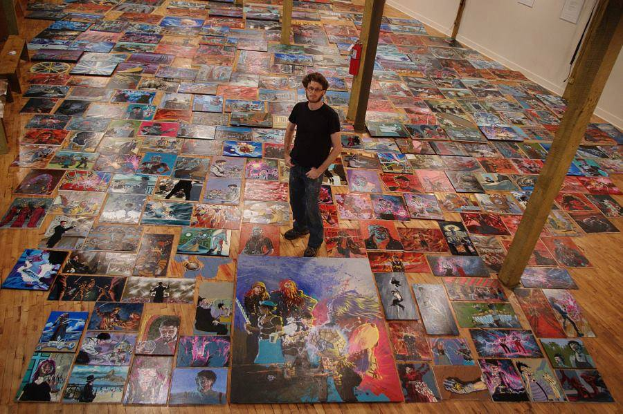 David Landry pictured with all 321 paintings (from Facebook)