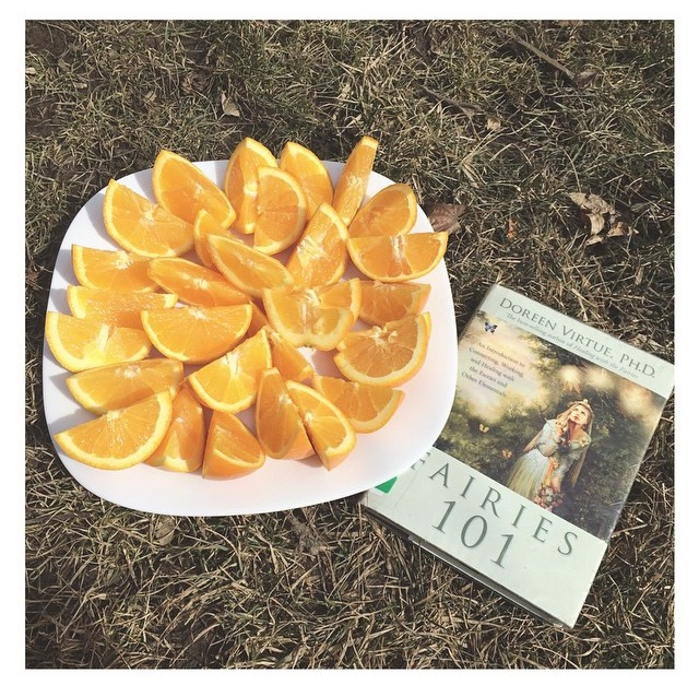 Lauren @blondeveganhippie of Toronto, Canada, with her plate of organic oranges and Fairies 101.