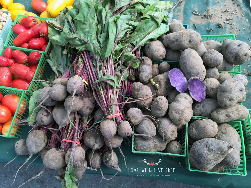 Organic heritage purple potatoes, beets and heirloom tomatoes from Haystrom Farms at Toronto's Evergreen Brick Works.   Photo by LoveWildLiveFree.