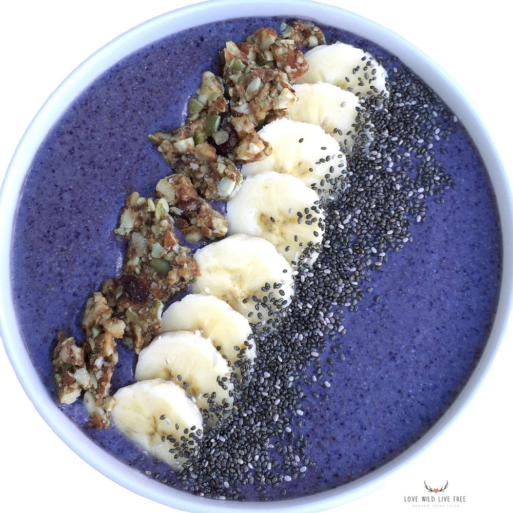 Blueberry smoothie bowl topped with Koukla Delights Cranberry Maple Granola.  Photo by Love Wild Live Free.