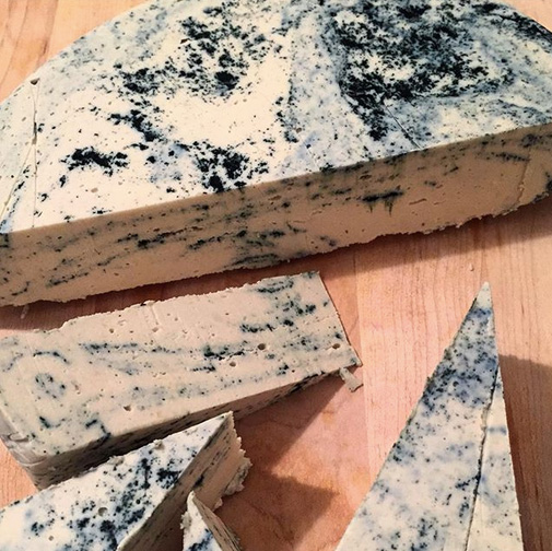 "Nuts For Cheese will be at the vegan Food Fest with their delicious cheeses, like ""Un-Brie-Lievable"" - soft and creamy coconut cashew blend. Sharp, rich, and marbled with spirulina.  Photo by: Nuts For Cheese."