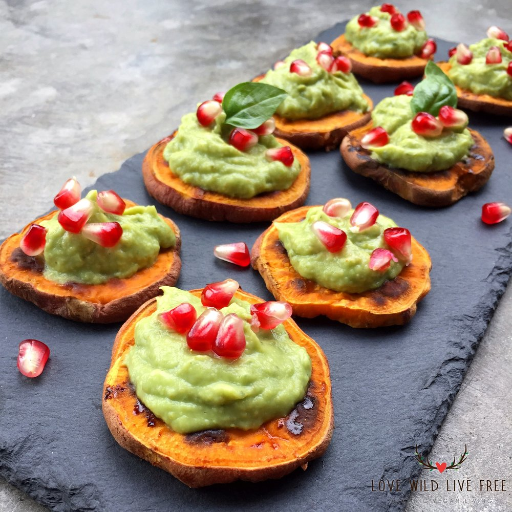 "Sweet Potato ""Crostini"" with Avocado-Pesto and Pomegranate for the Ultimate Vegan Thanksgiving.  Photo by Love Wild Live Free."
