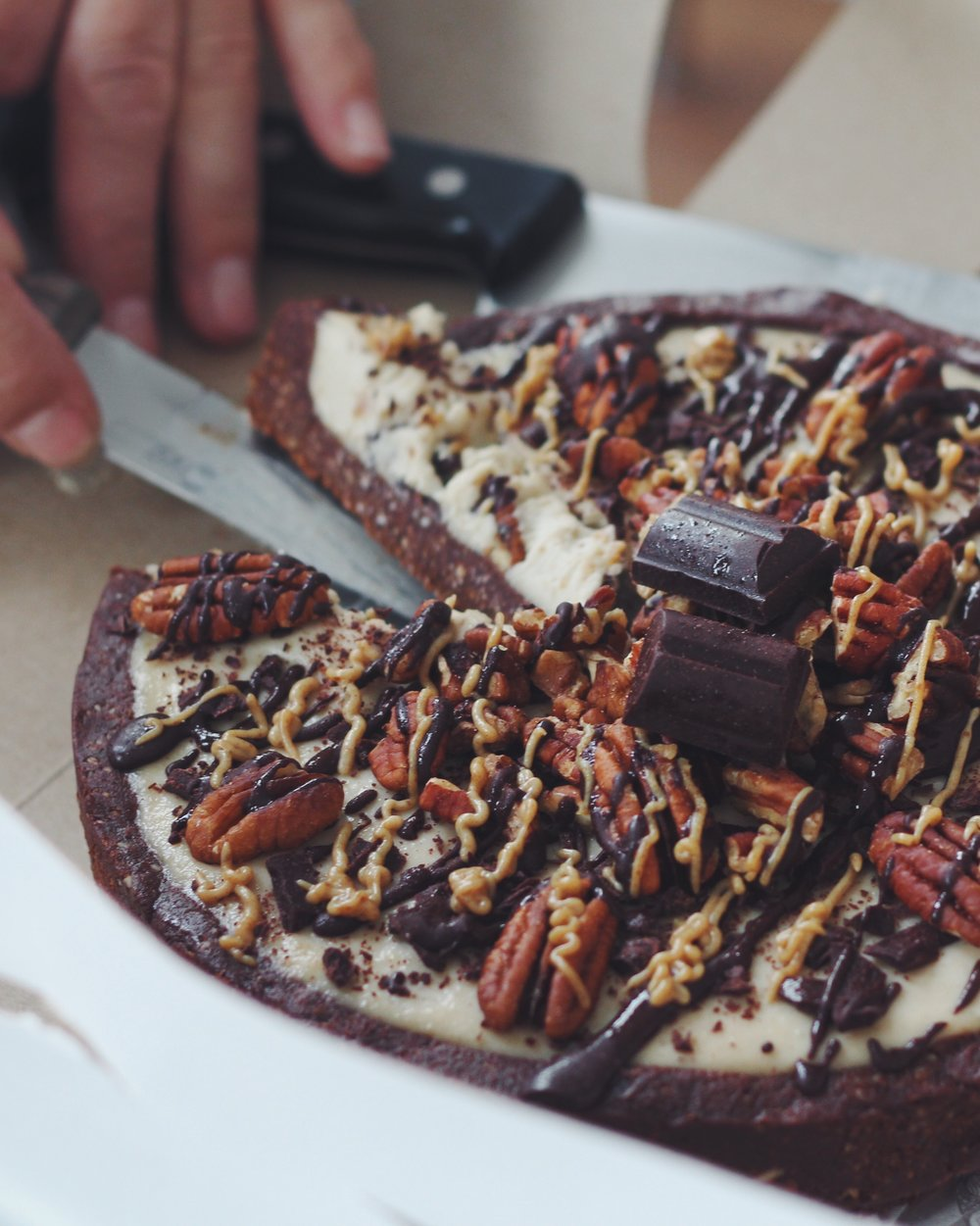 "This decadent ""Treatzza Pizza"" is topped with chocolate, caramel and pecans too!  Photo by: Tim Donnelly.  Photo courtesy of Sweet Hart Kitchen."