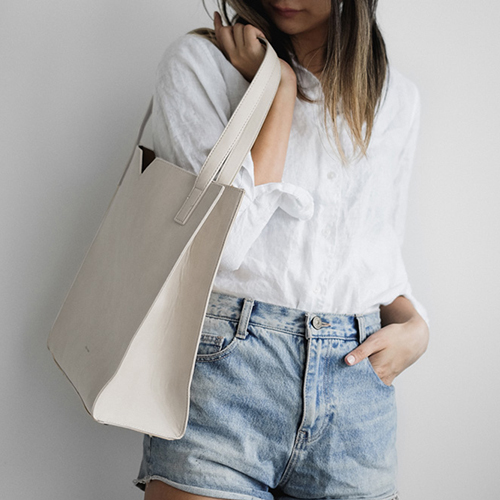 The  Alicia Soft Tote  in Cream by Pixie Mood is a soft tote bag, made with vegan leather.  Photograph by Pixie Mood.