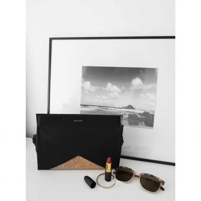 The Margaret Clutch  by Pixie Mood, with plain cork and black vegan leather, is the perfect accessory for a night on the town!   Photograph by Pixie Mood.