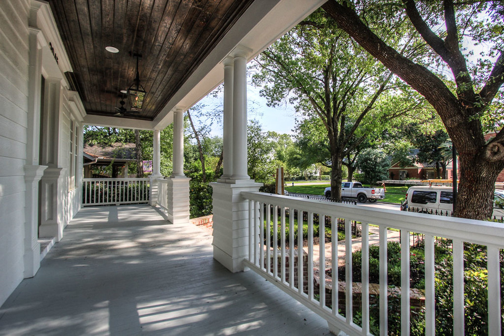 A deep front porch frames the inviting front entrance and is a welcoming area to sit and enjoy the peacefulness and sense of community that the Houston Heights is so well known for.