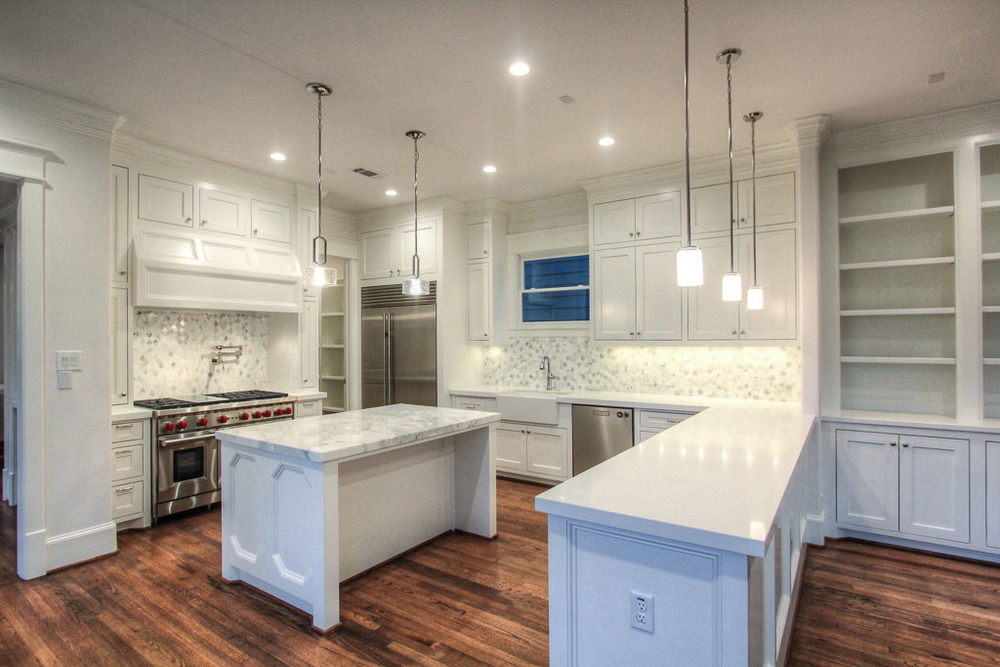 Generous Carrara & Calacatta Gold marble selections in the kitchen, with equally abundant counter space from the island and an extended counter overlooking the great room. Perfect for entertaining.