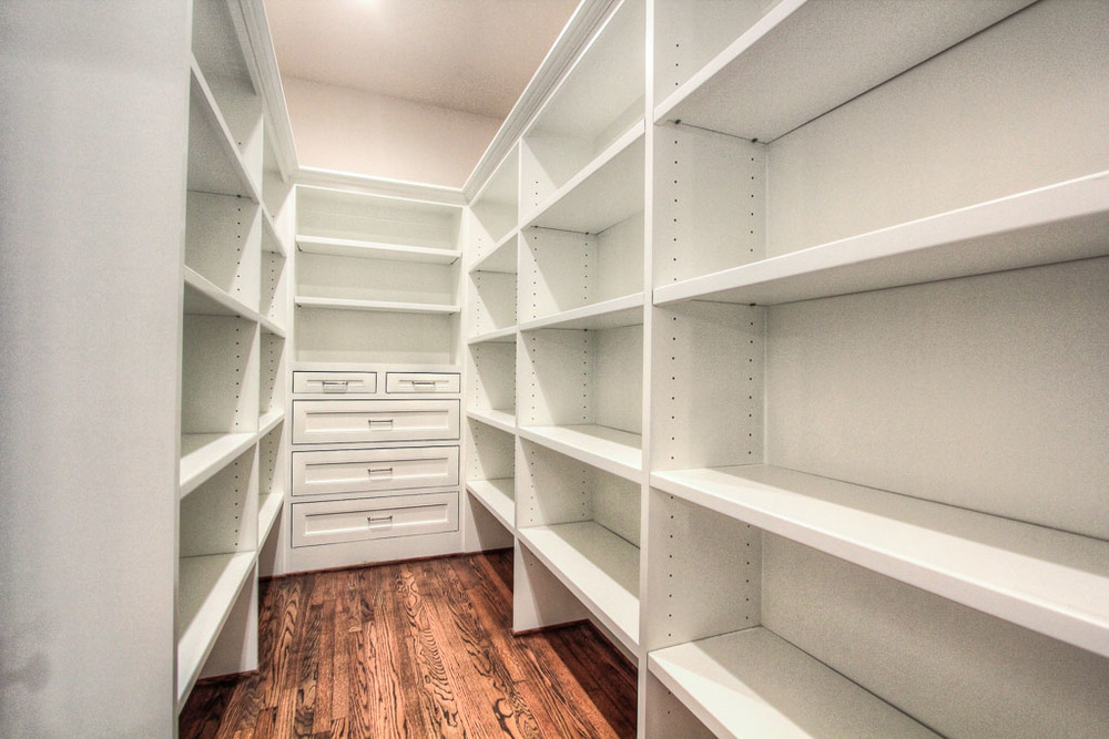 The large walk-in pantry has a lot of built-in storage.