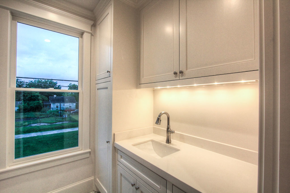 The utility room also has marble counters and an operable window.