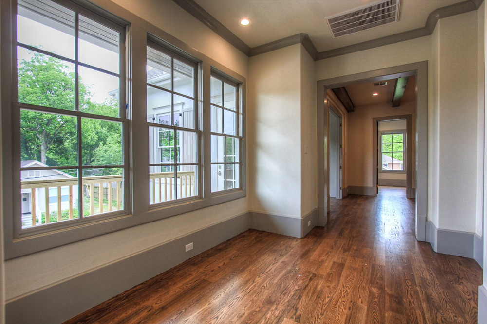 This very wide second floor hallway could comfortably be used as a seating area or reading nook.