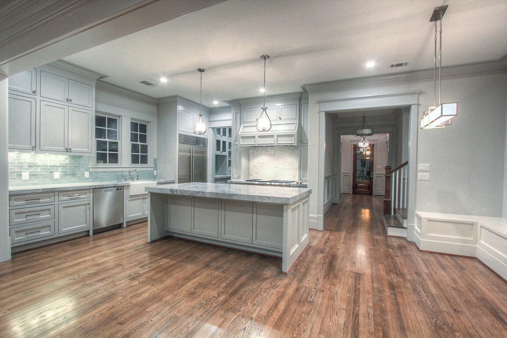 The kitchen and breakfast area, both open and functional, are the heart of the downstairs living area. This area connects to both the formal dining and butler's pantry as well as the great room and guest quarters.