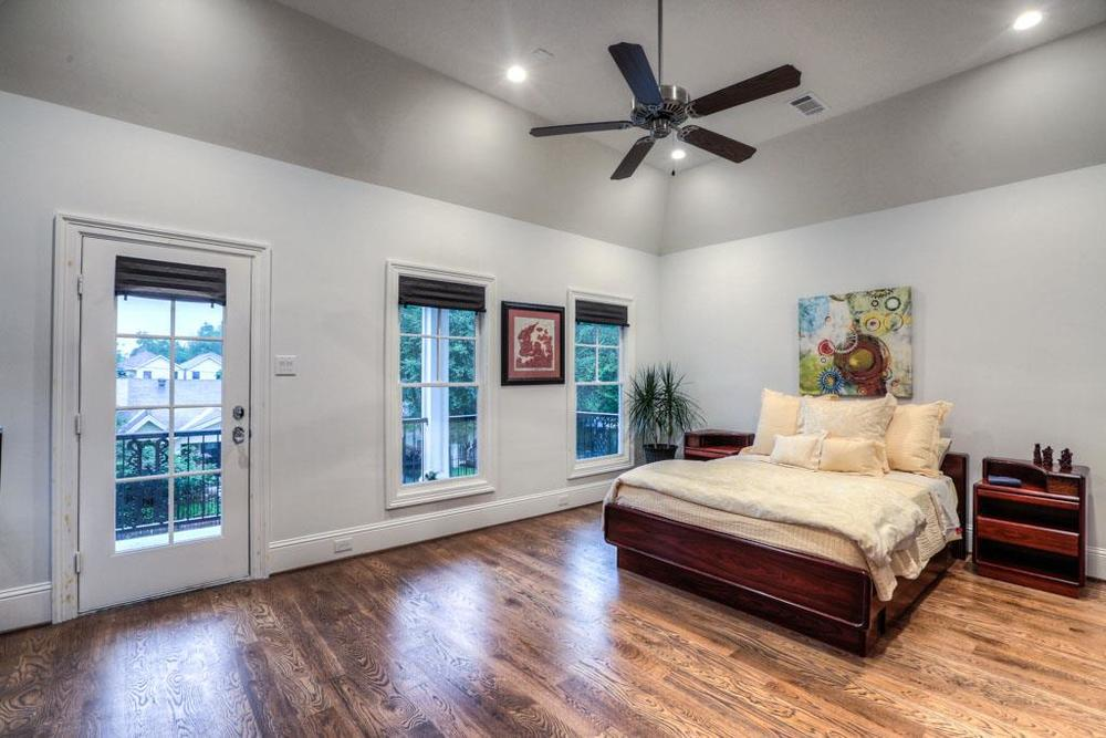 Spacious master bedroom is beautifully enhanced with natural light. This room has it's own private porch.