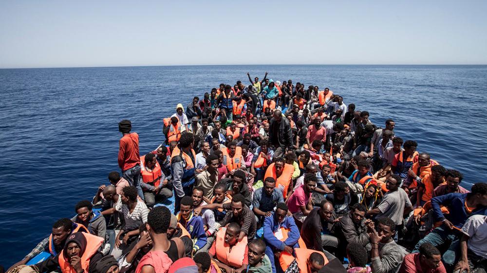 Eritrean migrants in the Mediterranean Sea. Click Image for Source