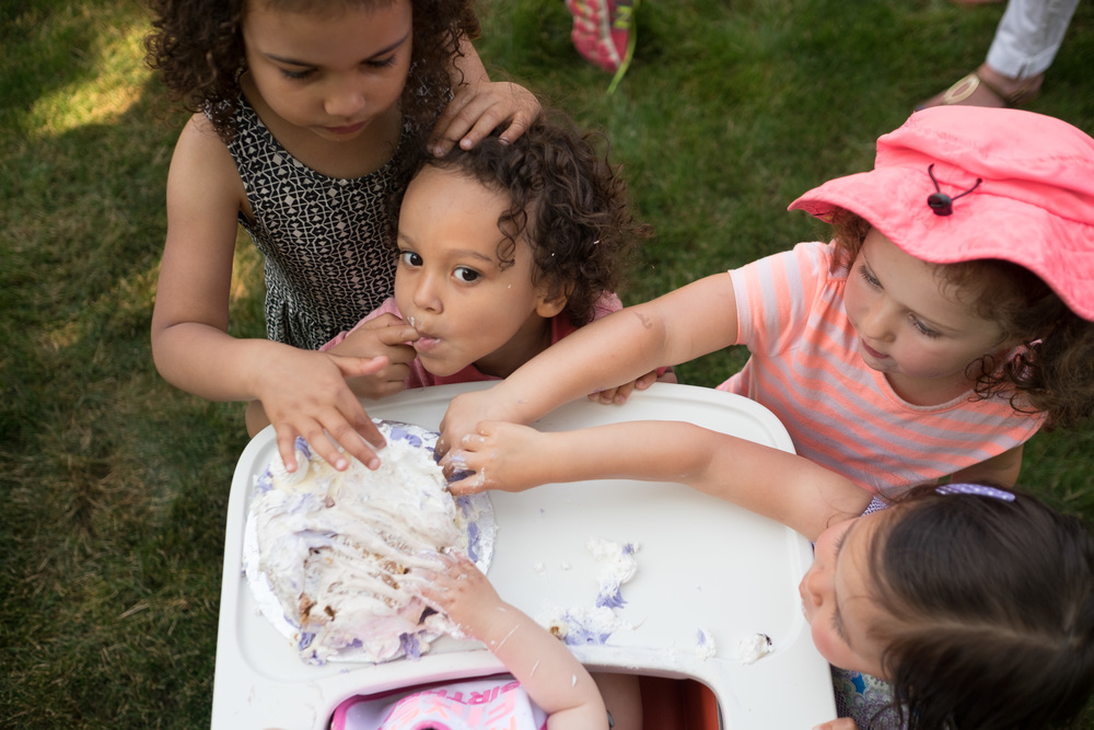A photograph by toronto family photographer Scott Williams of a first birthday party.