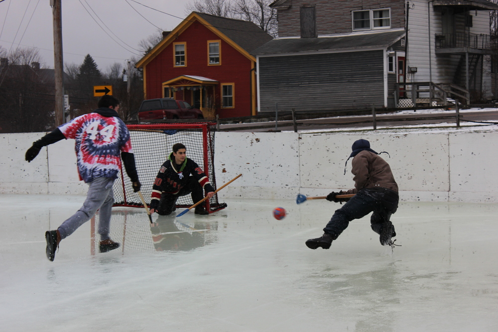 This weekend was my town's annual broomball tournament. Here, my son, airborne, takes a shot on goal.