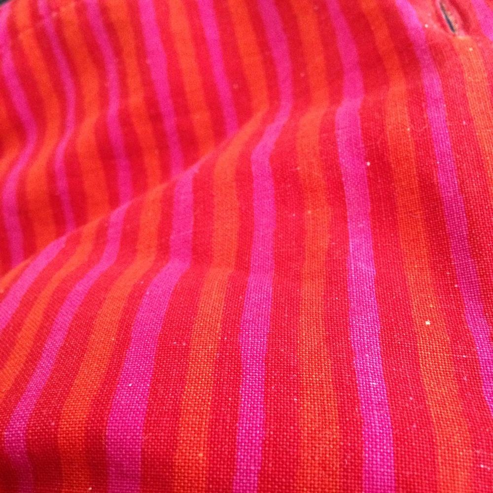 The original photo: closeup of my red/orange/hot pink striped Marimekko shirt.