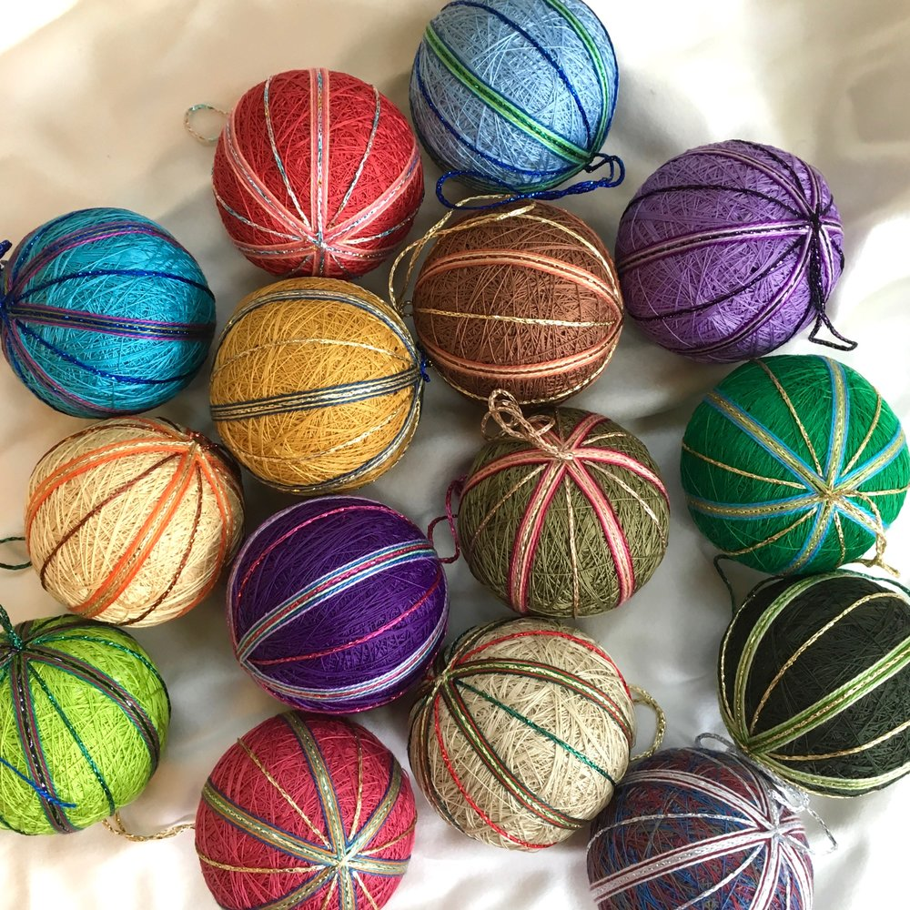Just finished this clutch of small temari ornaments. I'll have these, and many more as well.