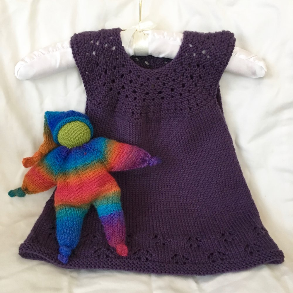 The doll: pattern is Knubbelchen by pezi888 (on Ravelry); yarn is Viking of Norway Nordlys, I can't remember the colorway... The dress: pattern is Orange Creme by Taiga Hilliard Designs; yarn is Valley Yarns Haydenville, color 12 Purple.