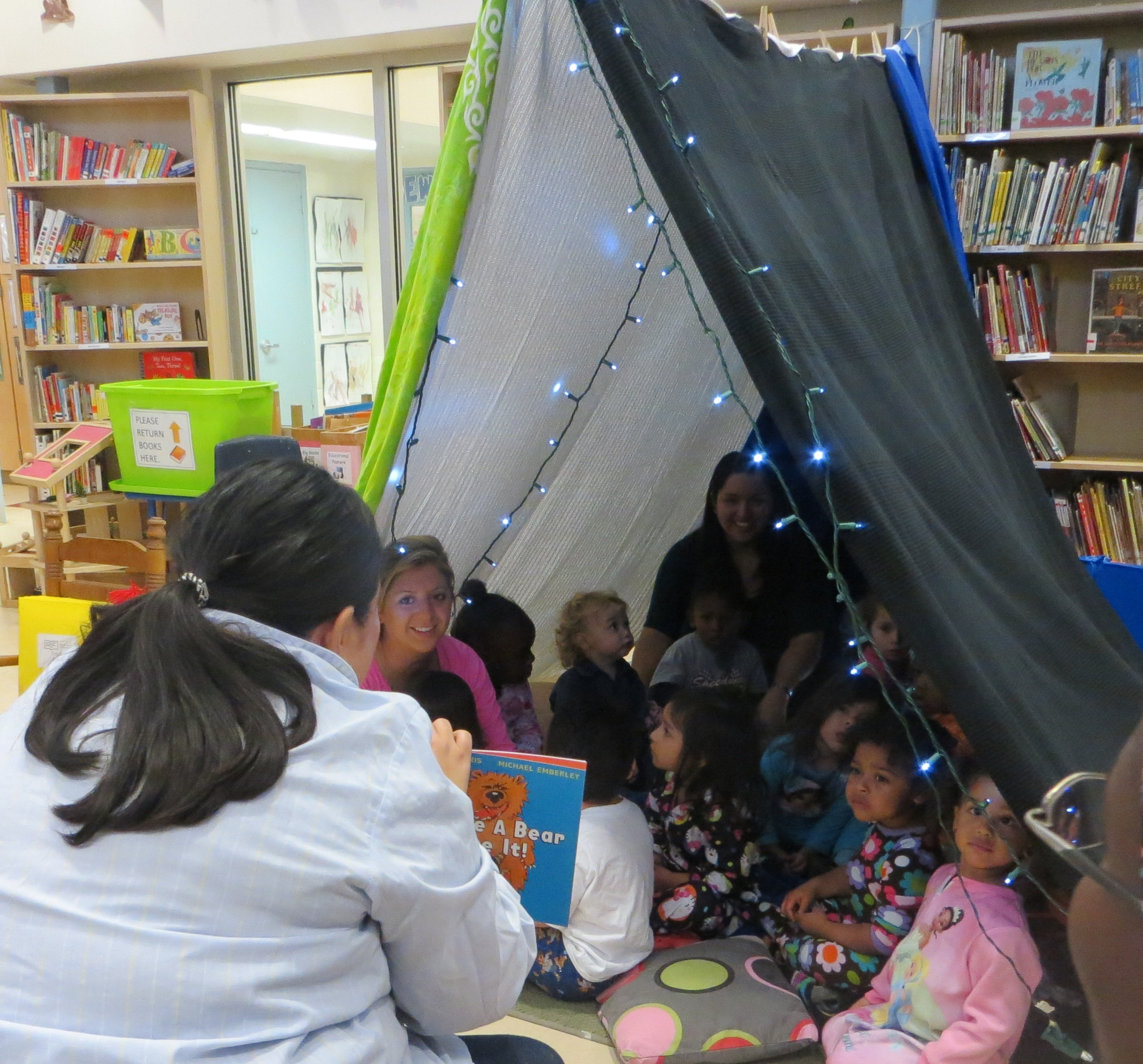 Grasshoppers enjoy a good book under the fort in celebration of RIF day.