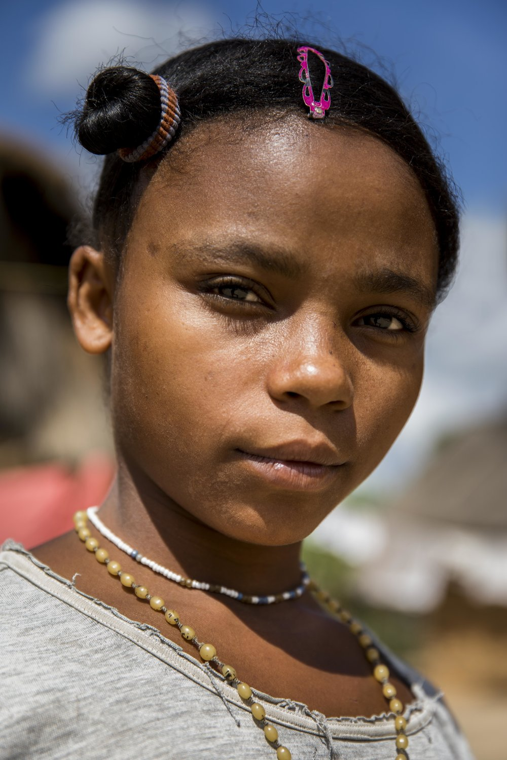 Angeline is 19 years old. She has 7 siblings, loves to talk but is sometimes shy. She was born and has lived in Amberomena her own life. She collects water 3 times a day with her mother. Health is her number one priority and she believes clean water will give her and her family just that.