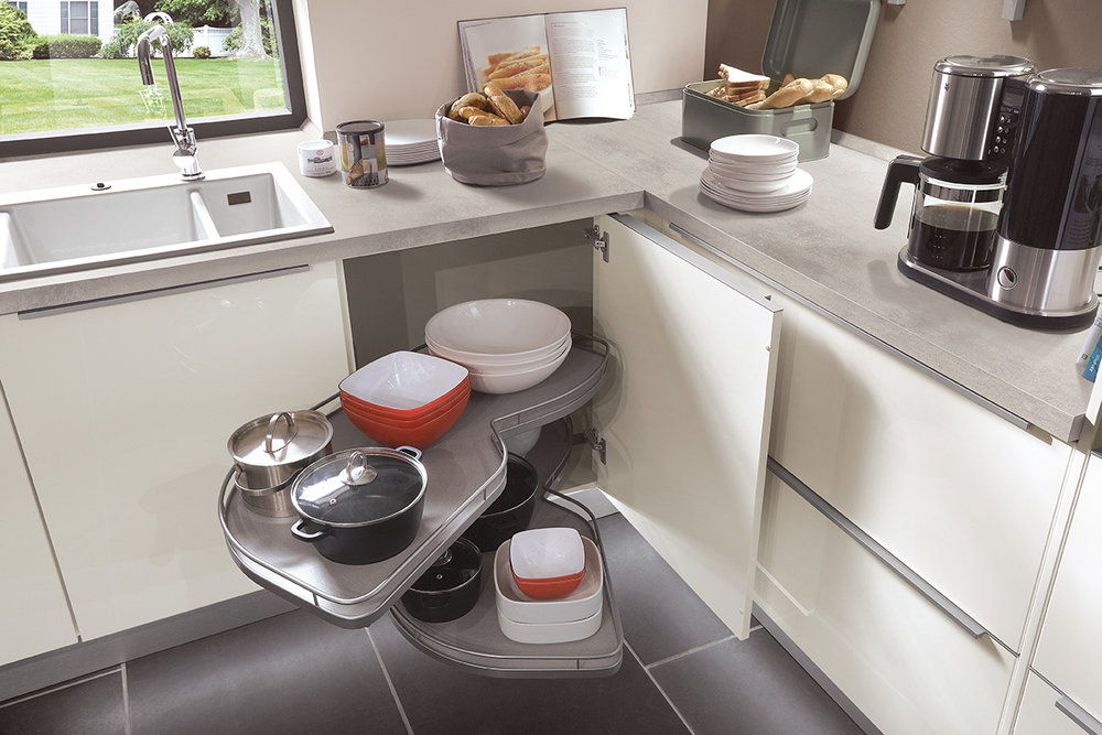 AMPLE STORAGE - In an Evoke Kitchen, every inch of space is used to its full potential: with excellently engineered le mans and corner units, intelligent under-counter storage and ergonomically designed wall units, all while maintaining that elegant Evoke style.