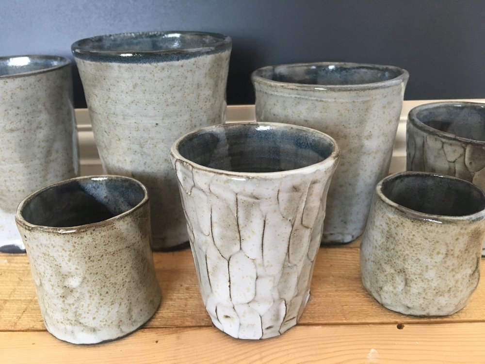 black clay tumblers