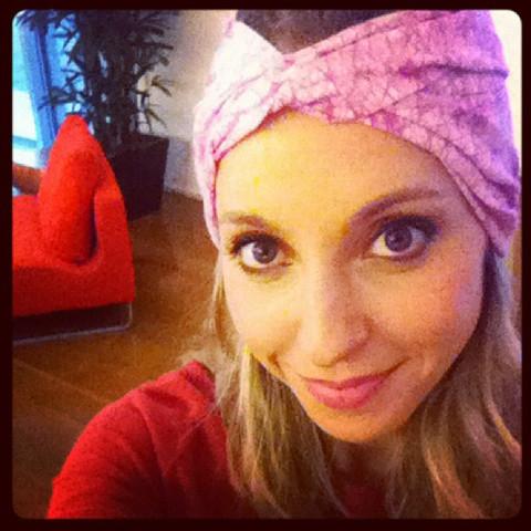 Gabby Bernstein wearing her Raspberry Glow ENSO Batik Headband